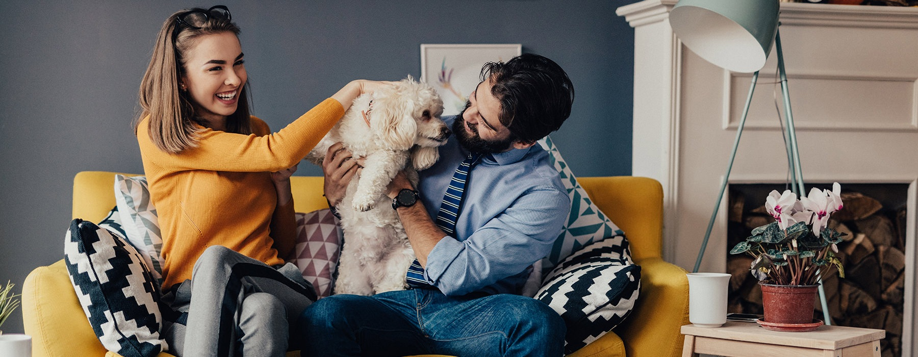 couple on the couch with dog